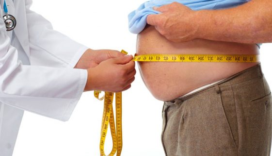 45282834 - doctor measuring obese man waist body fat. obesity and weight loss.