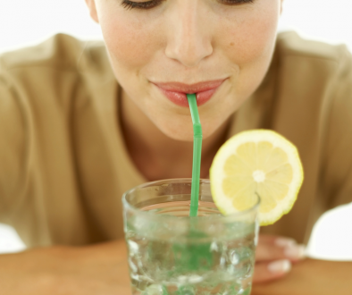 woman-drinking-lemon-water